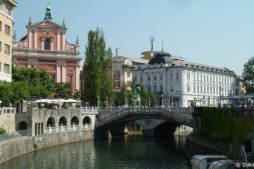Ljubljanica, la rivière, les Trois Ponts et l'église franciscaine